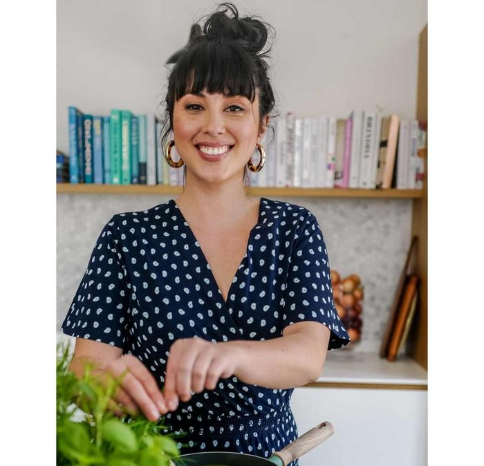 Chef, bestselling cookbook author, Fairtrade and sustainability champion, Melissa Hemsley, cooking in her kitchen.