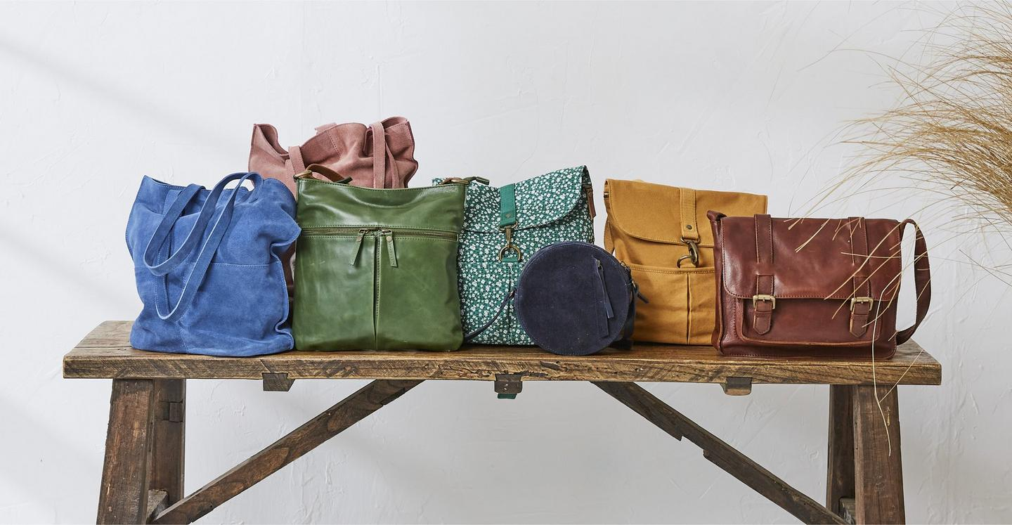 A selection of women's suede, canvas & leather rucksacks & tote bags, in a variety of colours.