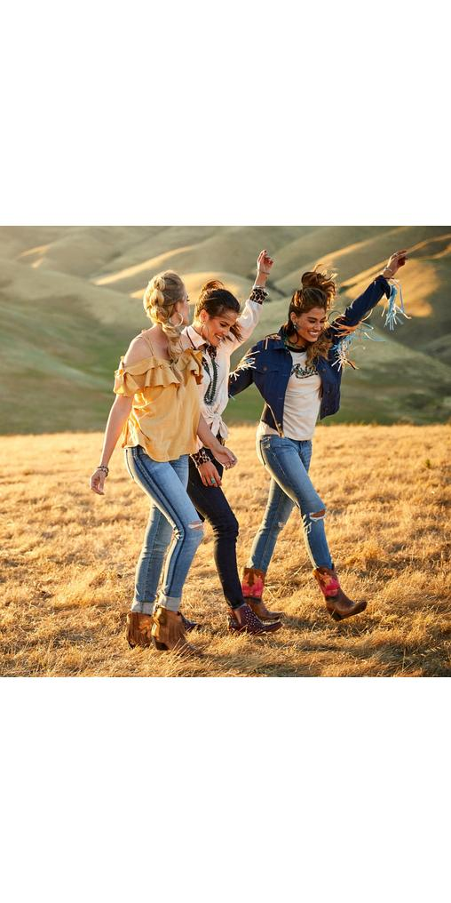 Three women in Ariat apparel and shoes