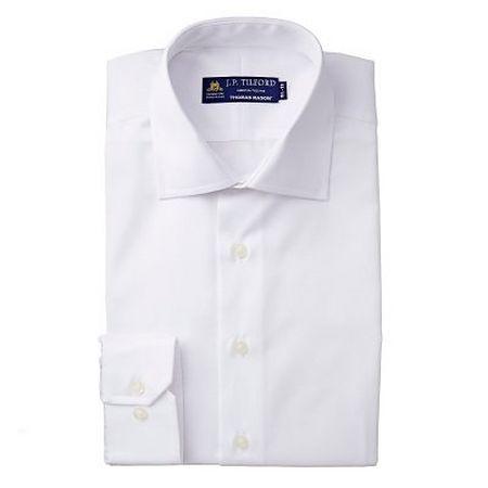 Adjustable button cuff on white dress shirt
