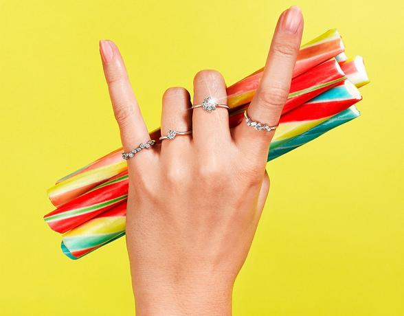 Rock on hand sign wearing Diamond Rings